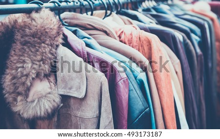 Selective focus second hand of Winter clothes hanged on a clothes rack , retro picture style