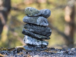 Selective focus shot of a pile of rocks with copy space for text