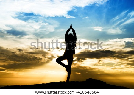 selective focus silhouette woman yoga on top mountain