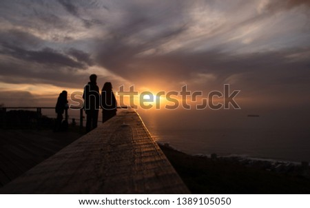 Selective focus  Tourist is taking a picture of sunset at view point . capetown . south africa