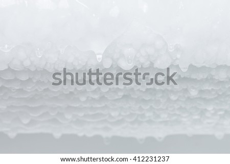 selective focus Water dripping from ice refrigerator freezer #412231237