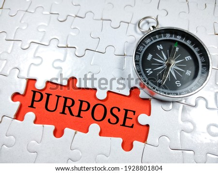 Selective focus.Word PURPOSE with compass on jigsaw puzzle and red background.Business concept. Stock photo ©