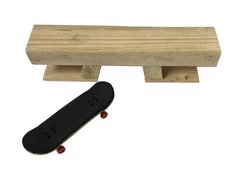 Selective focused photo of a fingerboard skateboard and a bench obstacle isolated on off white background with copyspace for runaround or wraparound text