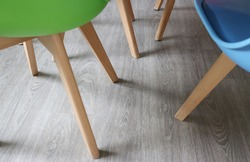 Selective focused photo of legs of chairs with space for runaround or wraparound text concept of socialising