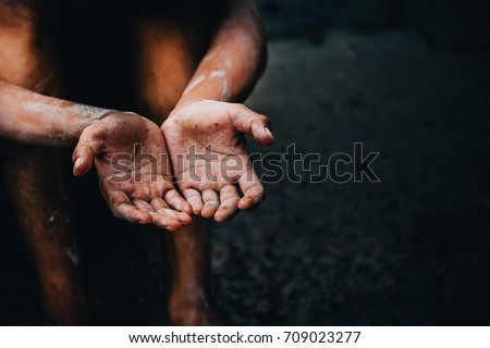 selective soft focus. hands poor child begging you for help concept for poverty or hunger people, Human Rights,background text.