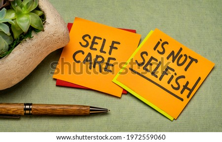 self care is not selfish inspirational reminder - handwriting on sticky notes, body positive, mental health and personal development slogan Stock photo ©