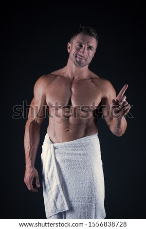 Self care. Man muscular fit bare torso. Athlete with six pack and ab muscles. Sport and fitness. Body hygiene concept. Bodybuilder perfect naked body. Sexy sportsman wipe body towel after shower.