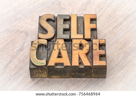 self-care word abstract in vintage letterpress wood type #756468964
