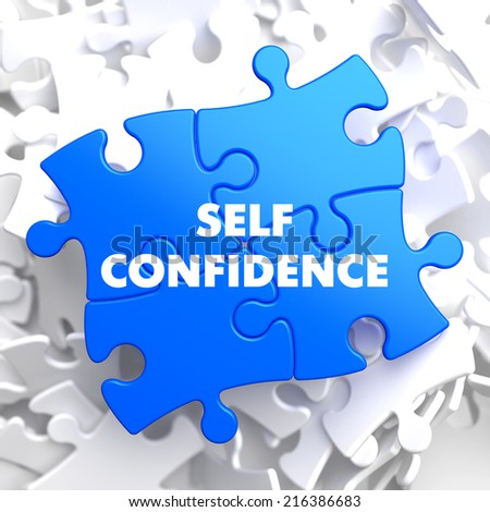 Self Confidence on Blue Puzzle on White Background.