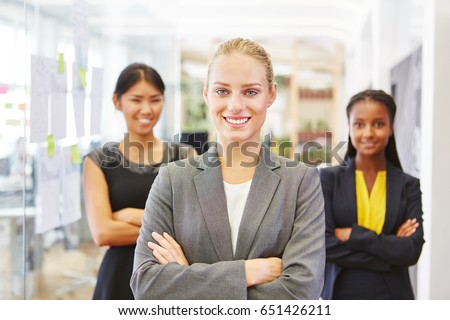 Self confident woman as consultant and her team
