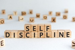 Self discipline - words from wooden blocks with letters, self-discipline concept, random letters around, white  background
