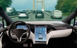 Self driving car on a road. Autonomous driverless vehicle with artificial intelligence. Inside view.