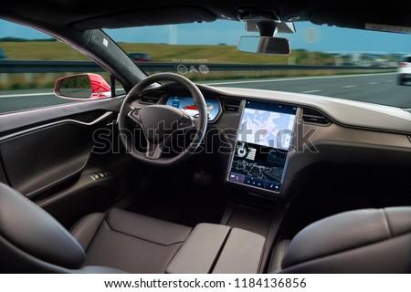 Self driving car on a road. Autonomous vehicle. Inside view. #1184136856