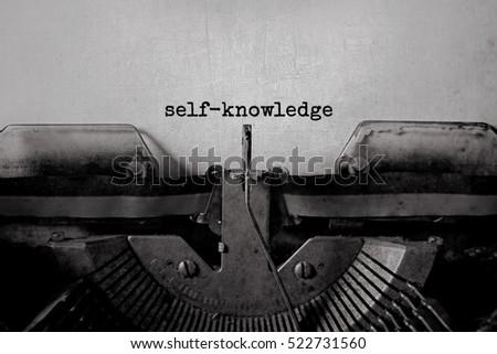self-knowledge typed words on a vintage typewriter