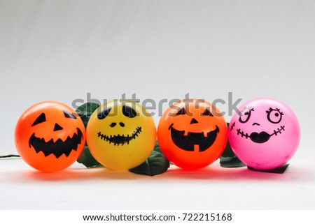 Self Made hand drown Smiley face Halloween Spooky balls in orange,yellow and pink with white background - copy space template for your wording #722215168
