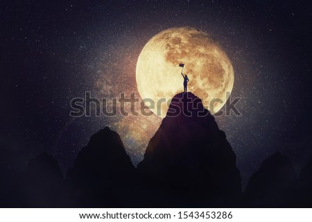 Self overcome concept as a woman on the top raises the finish flag after climbing the mountain obstacles. Road to win with up and downs, success achieving and conquer. Motivation for achieving goals.