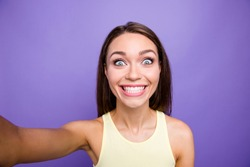 Self-portrait of nice crazy dreamy adorable charming attractive brunette straight-haired girl staring eyes grinning white teeth isolated over violet purple background