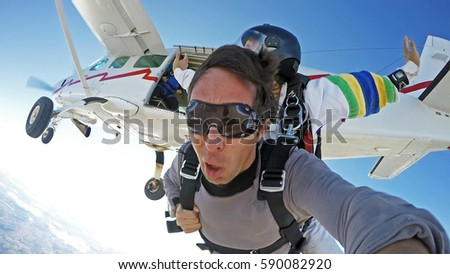 Self portrait skydiving tandem jump from the plane #590082920