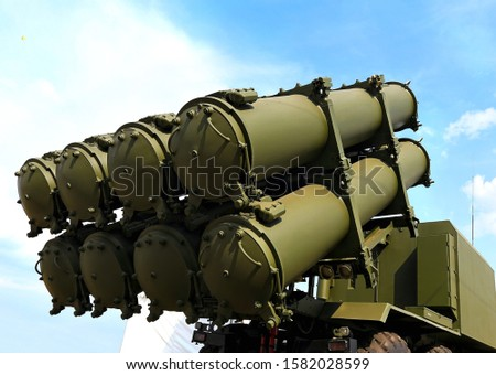 Self-propelled launcher onshore missile system with missiles in transport and launch containers