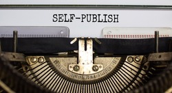 Self-publish symbol. Words 'self-publish' typed on retro typewriter. Business and self-publish concept. Beautiful background.