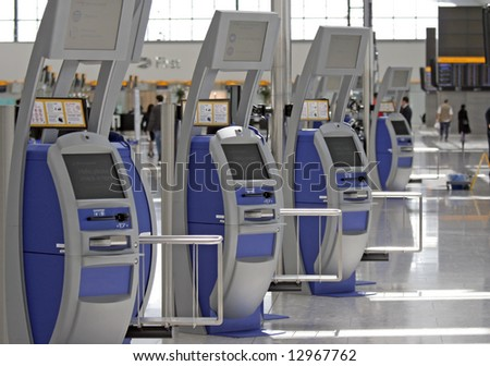 Self service check in stations at Terminal 5 Heathrow Airport