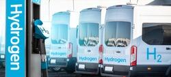 Self service hydrogen filling station on a background of buses