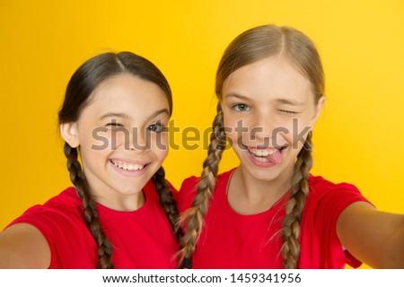 Selfie for social networks or blog. Blogging modern trend. Personal blog. Capturing moments. Child girls taking photo. Children kids happy faces. Video call concept. Blog online. Girls taking photo.