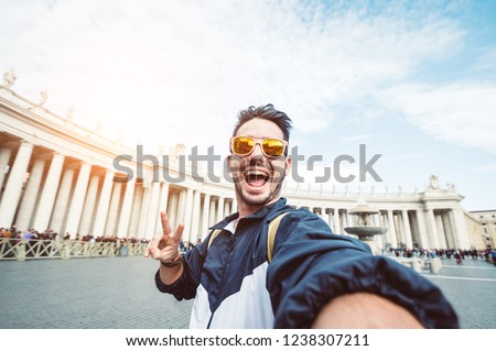 Selfie of a beatiful caucasian man tourist in Rome at Vatican city on vacation
