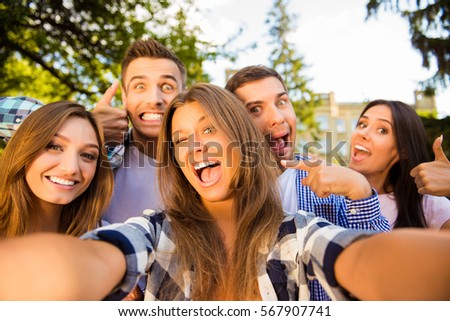 Selfie of five happy comic friends with beaming smiles.