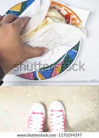 Selfie of kabab Turkey food and red sneakers #1170294397