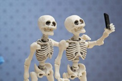 Selfie, self portrait with skeletons
