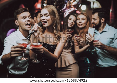 Selfie. Sing and Drink. Black Dress. Trendy Nightclub. Have Fun. Background. Cheerful. Smiling Girl. Singing Songs. Handsome Men. Beautiful Girls. Friends at Karaoke Club. Karaoke Club. Celebration.