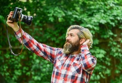 selfie time. vintage camera. capture these memories. SLR camera. hipster man with beard use professional camera. photographer hold retro camera. journalist is my career. reporter make photo.