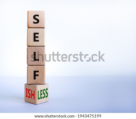 Selfish or selfless symbol. Turned cubes and changed the word 'selfish' to 'selfless'. Beautiful white background, copy space. Business, psuchological and selfish or selfless concept. Stock photo ©