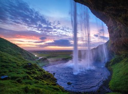 Seljalandfoss waterfall at sunset, Iceland. Horizontal shot.