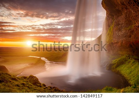 Seljalandsfoss is one of the most beautiful waterfalls on the Iceland It is located on the South of the island This photo is taken during the incredible sunset at approx 1 AM