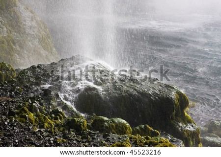 Seljalandsfoss, one of Iceland's large waterfalls, hits the rocks.