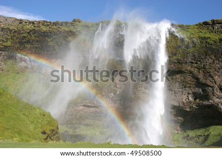 Seljalandsfoss, one of the many waterfalls on Iceland. Wind pushing back the water!