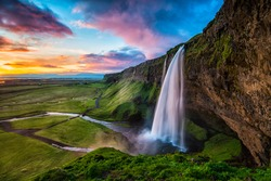 Seljalandsfoss - Seljalandsfoss is located in the South Region in Iceland right by Route 1. One of the interesting things about this waterfall is that visitors can walk behind it into a small cave.