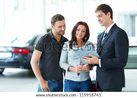 Seller and a couple in the showroom