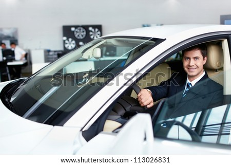 Seller in the car in a motor show