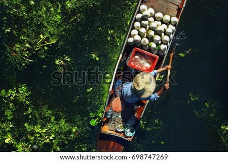Seller on boat , floating market ,Thailand #698747269