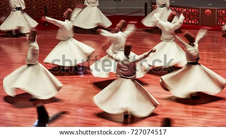 Semazen or Whirling Dervishes, Konya. Sufi whirling dervish (Semazen) dances at . Semazen conveys God's spiritual gift to those are witnessing the ritual. Stock photo ©