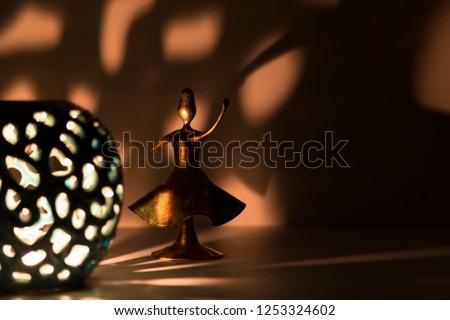 Semazen praying and turning to Allah under soft light for Ramadan,world peace and health. Friday message concept or religious background photo. Seb-i Arus and Mevlana ritual. Stock fotó ©