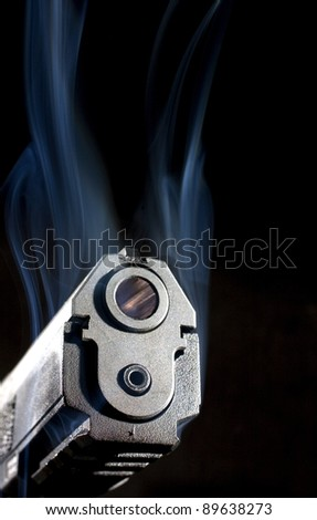 Semi-automatic pistol that has smoke coming from its slide