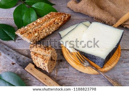 Semi-cured cheese and seed bread