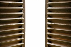 Semi-open dark wooden shutters close-up isolated. For presentations of cities, landscapes.