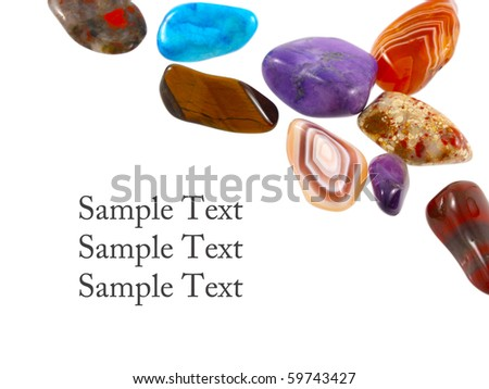 Semi-precious stones against white background with room for text