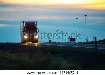 Semi truck at dusk #1173455941