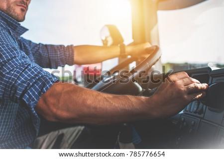 Semi Truck Driver Job. Caucasian Trucker Preparing For Long Haul Shipping.